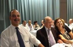 Mayor Theothori Koukoulis sitting with f..