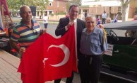 There was also a supreme gesture of reconciliation with the Turkish flag also on display