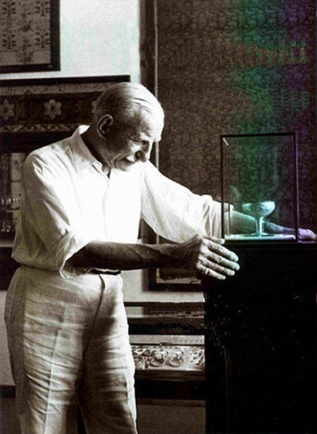 Antonis Benakis in 1950, examining a gold kylix from Dendra in the Argolid.