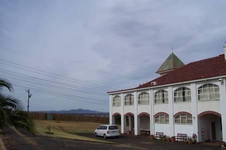 Looking Eastwards to Cox Road & Melbourne. Monastery building. - 100_1247