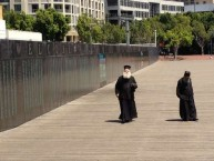 The Metropoliti of Kythera, and father Petros were fascinated by the Welcome Wall at Darling Harbour