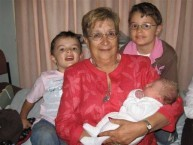 Proud grandmother with her grandsons.