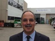Theothori Koukoulis, Mayor of Kythera, outside Con Gavriles Astor Base Metals factory