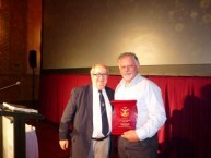 John Theodoridis, Grand President of AHEPA, NSW presenting Peter Prineas