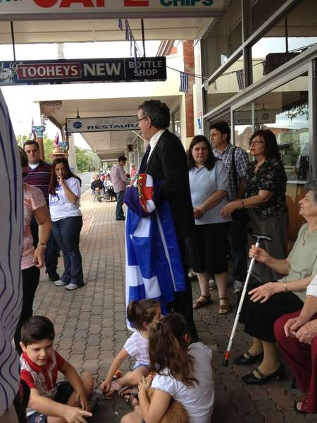"""George Poulos, the """"flag man"""" added much colour with his flag displays"""