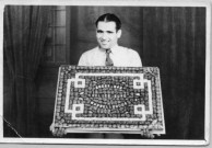Harry Aliferis, holding a box of chocolates, to be used as a means of raising funds for the Greek War Relief Fund.