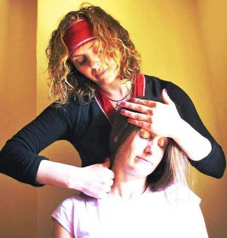 Nataly practicing Ayurovedic Therapy