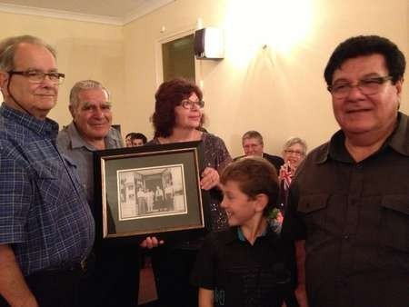 The Smiles family presented the Calokerinos family with a photograph of the original owners