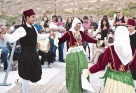 Local children dancing at the ayiasmos at Avlemonas