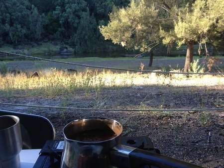 Looking across the brikki that boiled the coffee towards a beautiful creek