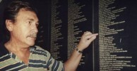 Peter Sophios pointing to his father Dave's entry on the Welcome Wall