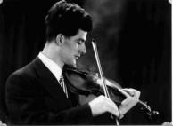 Con Simos playing the violin.