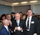 Prime Minister of Australia, John Howard, with Secretary of the Kytherian Association of Australia, George Poulos.