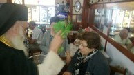 Mrs Diamanta Cassimatis, (nee) Stathis, receiving a blessing during the Canberra cafe celebrations