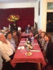 A happy table of friends and guests at the formal dinner to clebrate the Canberra cafe