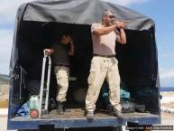 Unloading hundreds of kilograms of diving equipment.