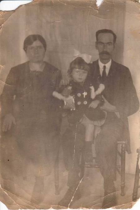 My sister Nina with her Godparents 1921