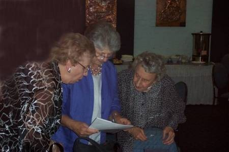 Doreen Moulos, Nell George and friend, comparing research notes.