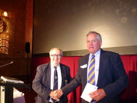 John Theodoridis presenting John Coulton with a cheque from AHEPA