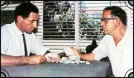 George Christianos showing author Archie Kalokerinos Opals from the 8 mile find