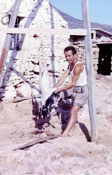 Emmanuel skinning a goat