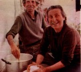 Mrs Metaxia Frilingos makes fresh mizithra cheese, assisted by Mr Andres Psaltis. 1976.