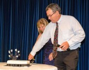 George Poulos cutting the 10th birthday cake for kythera-family.net