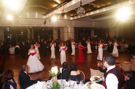 Matron of Honour, Debutantes, and their partners performing dance.