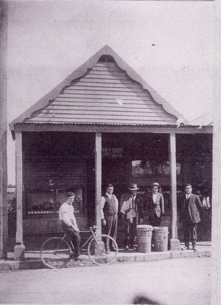 History of the Aroney Family in Nowra. - Group Picture Front of Greek Cafe