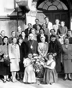 Greeks in the Far Orient - Greek and Russian parishioners pose with their bishop in front of a Greek-Orthodox church in Tokyo