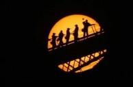 """Its a pretty big turnout for a dot"" ...tourists climbing the Harbour Bridge Jun 8, 2004, as Venus passes across the face of the sun."