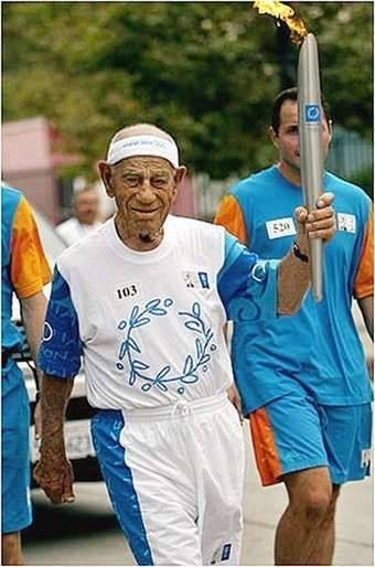 Peter Clentzos running with the Olympic torch, 2004, aged 95.
