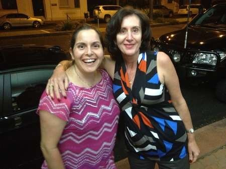 Gloria Tzannes and Irene Tzannes enjoying the friendly atmosphere of the Canberra cafe celebrations